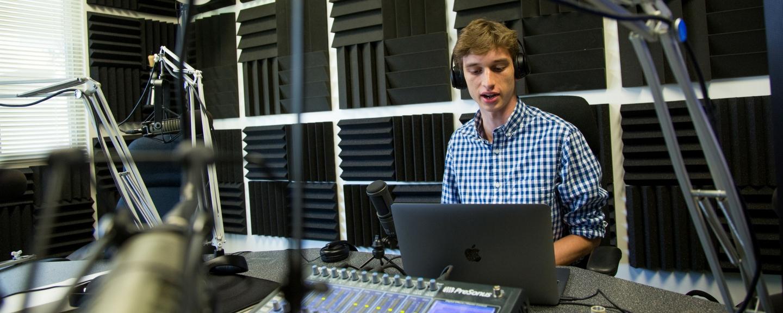 Jesse Friedman '20 in the Zu Radio broadcasting booth. <em>Photo by Paul Chung, University Relations</em>