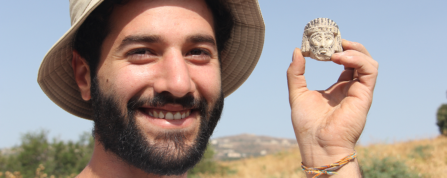 Mario Tobia, a student at Azrieli College of Engineering in Jerusalem, found this figure head on his first day at the excavation.
