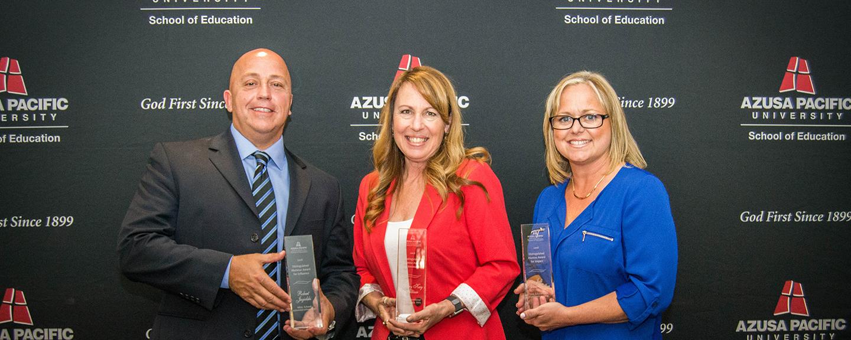 Robert Jagielski, Mary Kay Altizer, and Jodi Spoon-Sadlon with their Distinguished Alumni awards.