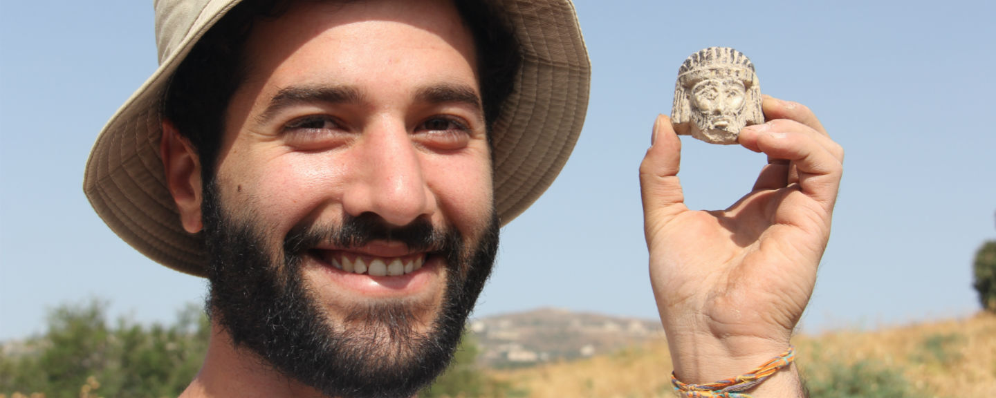 Mario Tobia, a student from Jerusalem, poses with the artifact.
