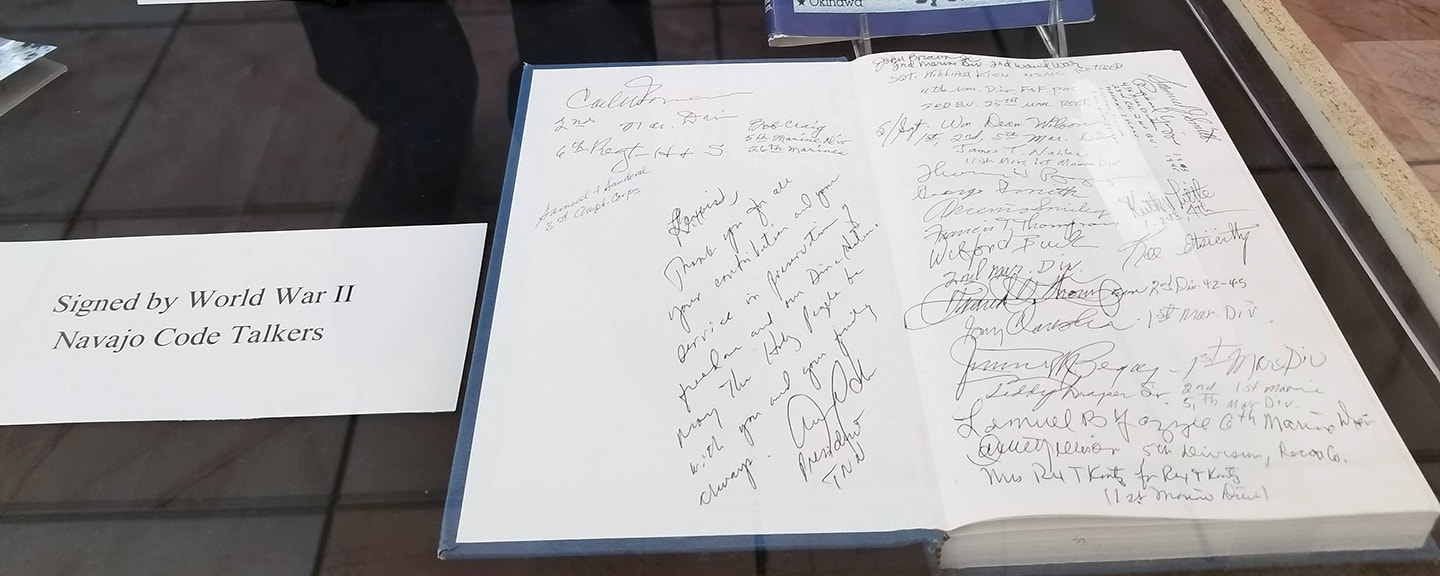 One of the displays includes a book signed by several of the original Navajo code talkers.