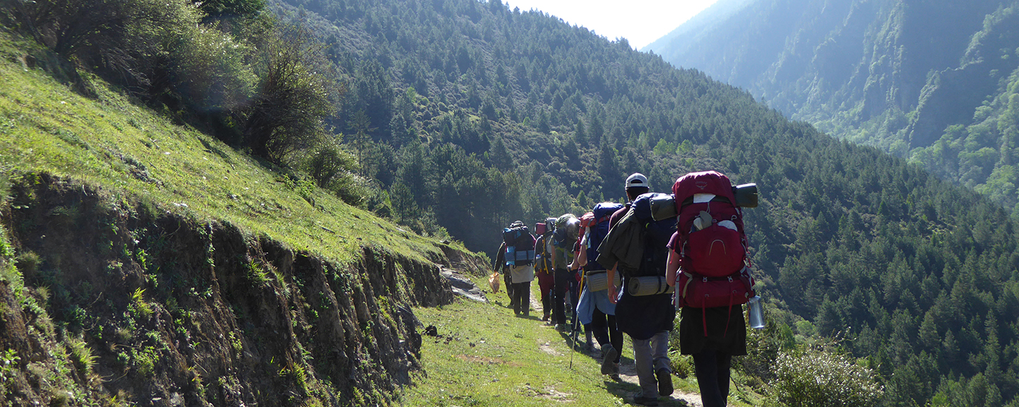 Action team backpacking through the Himilayas