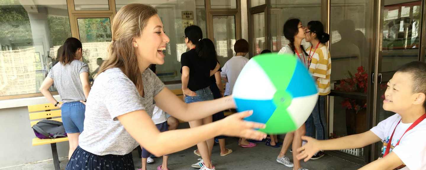 Reilly Fitzpatrick '20 (left) interacts with a child in China.