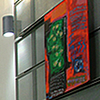 <strong>Inside Duke</strong><br>The Duke art hallway features artwork donated by past APU students. The two-story ceilings offer room for larger-than-life pieces that students enjoy as they head to their next class.