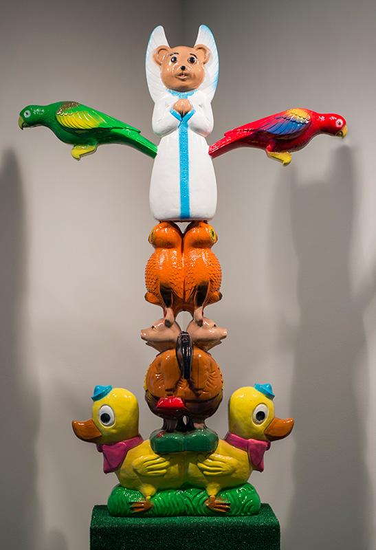 """Jeremie Riggleman<br><em>Winged Totem</em>, 2015<br>Plastic, concrete, foam, and paint<br>65""""x22""""x43"""""""