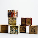 Laura Tabbut<br><em>Story Blocks</em>, 2014<br>Wood, Leather, Paper<br>4x4x4
