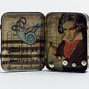Laura Tabbut<br><em>Elegy for Beethoven's Autopsy</em>, 2013<br>Lozenge Tin, Paper, Hearing Aid Batteries, Resin<br>3x5 in.